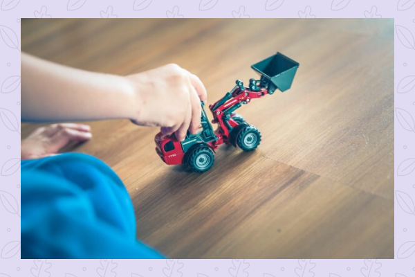 child playing with truck toy